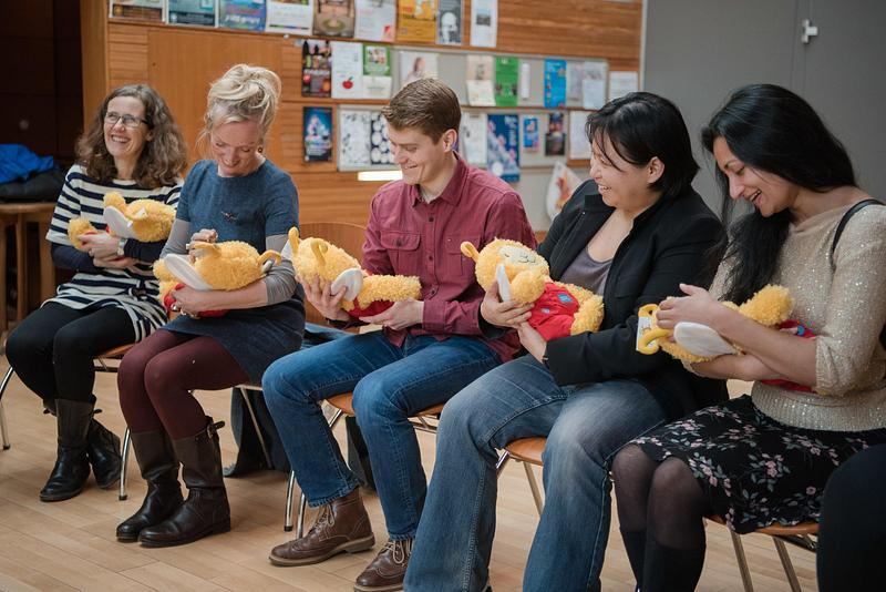 A group of adults taking part in a Bookbug training session