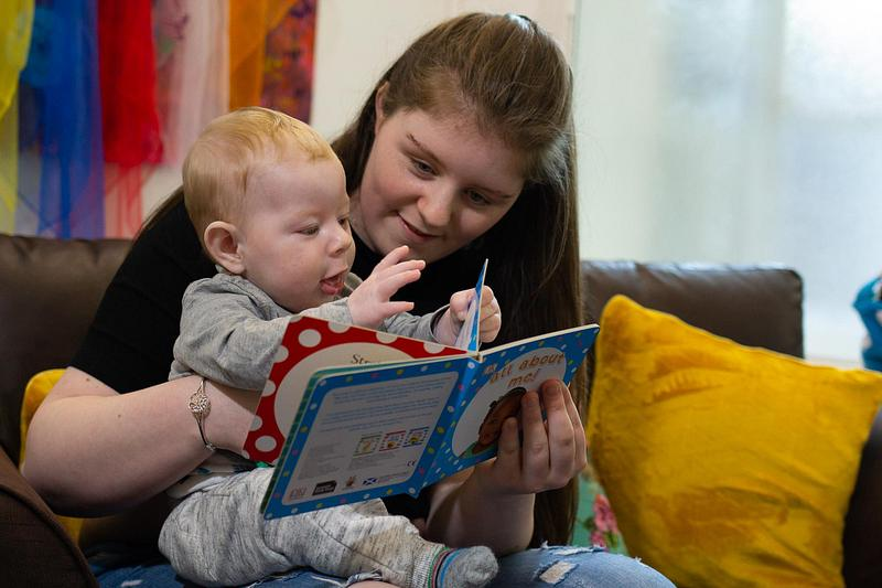 A mum and toddler reading together