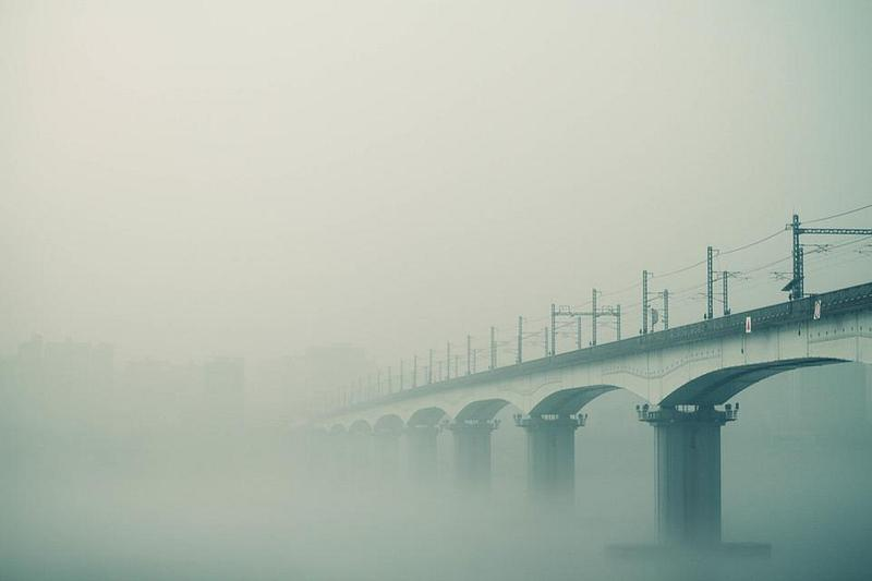 A bridge disappearing into fog