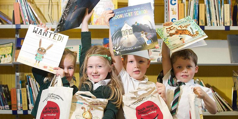 Children holding picture books