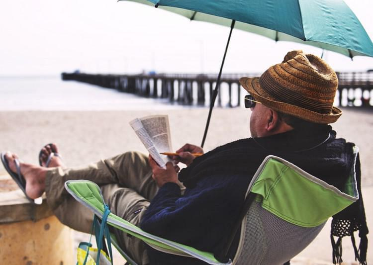 A man reading by the sea