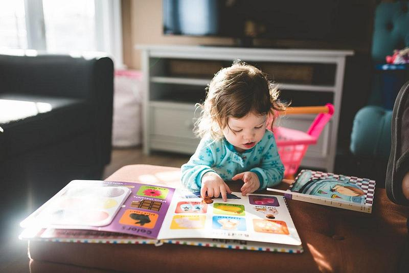 A young child reading a picture book