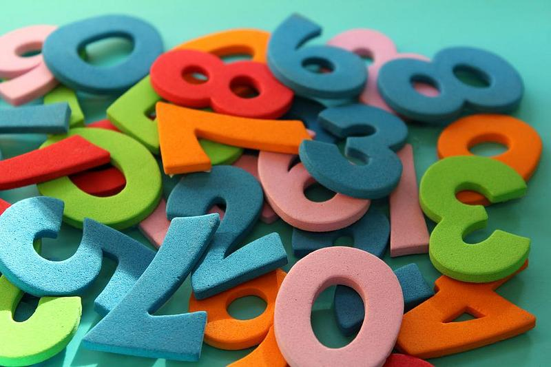 A pile of foam cut out numbers