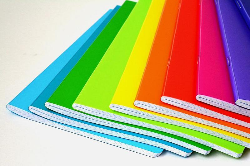 A pile of notebooks in different colours